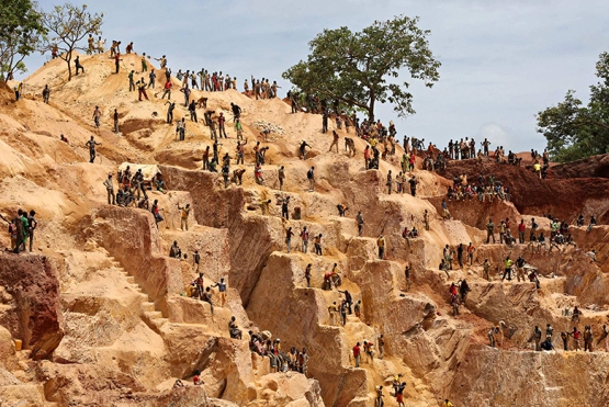 Prospectors work at the open-pit Djoubissi gold mine