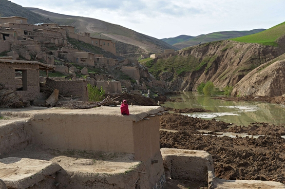 A villager near the site of a landslide in Argo district, Afghanistan