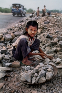 00485_04, Burma/Myanmar, 03/1995, BURMA-10232. A young girl collects rocks. retouched_Sonny Fabbri 5/21/2013